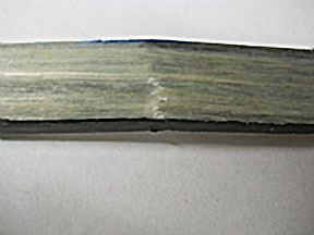 Figure 4B: Failure in tape-insert, injection-molded test-bars is in underlying 30% long glass fiber PP material.